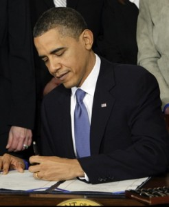 Obama signs the health care bill