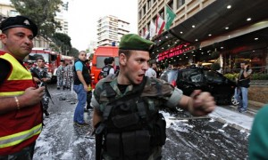 A Lebanese soldier outside the Duroy hotel in Beirut following the bomb attack